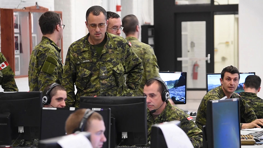 Slide - Soldiers in training on Virtual Battlefield System (VBS)