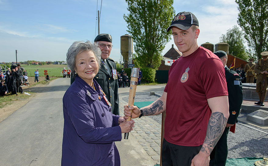 The Memorial Baton, is handed to the The Right Honourable Adrienne Clarkson, Colonel-in-Chief, Princess Patricia's Canadian Light Infantry (PPCLI) by Private Jake Dow, 2 PPCLI, after arriving at the Frezenberg Service and the end of its journey in Belgium, on May 8th, 2015. Photo:  MCpl Louis Brunet, Canadian Army Public Affairs, 3rd Can Div HQ