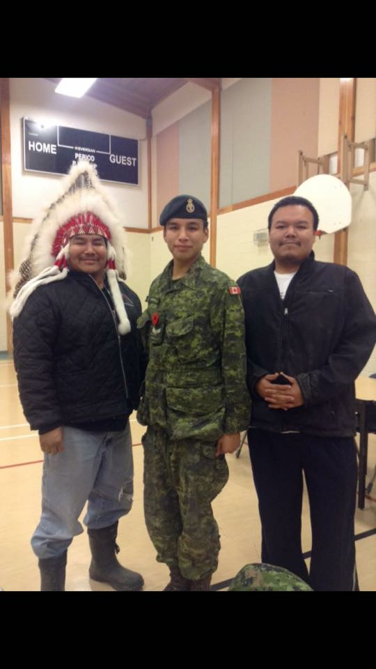 Following his Veteran's week presentation to students at Victoria Linklater Memorial School in North Spirit Lake First Nation, Ontario, Cpl Tyler Meekis is welcomed to the community by Deputy Chief Donald Campbell and council member Cory Rae. Photo by: Cpl Tyler Meekis, 2 PPCLI.