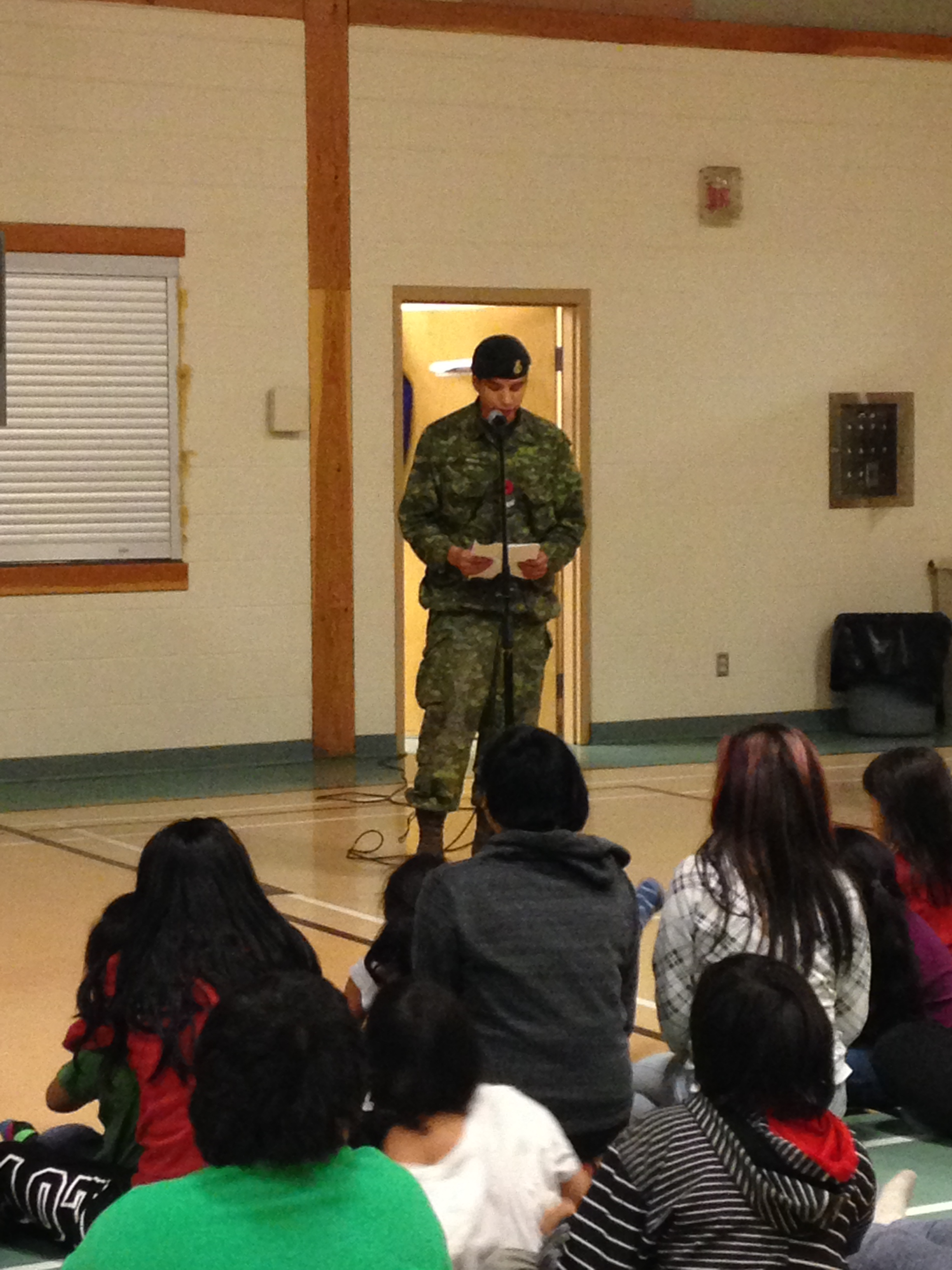 Nov 9 – Corporal Tyler Meekis speaks to students of Victoria Linklater Memorial School in North Spirit Lake First Nation in northern Ontario about his life in the Canadian Armed Forces and shares his experiences of what it means to serve. Photo courtesy of Adrian Lawrence, Principal, Victoria Linklater Memorial School, North Spirit Lake First Nation, Ontario.