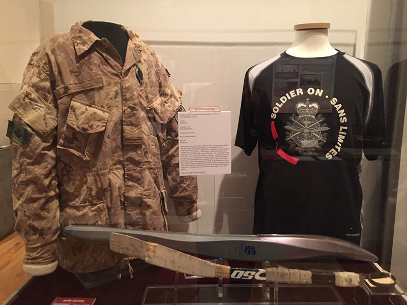 "A Lord Strathcona's Horse military tunic, Soldier On t-shirt, Olympic torch from the 2010 Paralympics, and sledge hockey stick are all items from Corporal Mark Fuchko, which help tell his story as part of the ""Play Hard, Fight Hard: Sport in the Canadian Military"" exhibit at The Military Museums in Calgary.