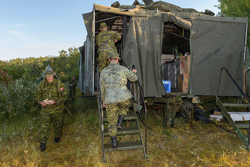 Members from 38 Service Battalion, and a few guests from other units, venture into the newly restored field kitchen for fresh cooked breakfast during Exercise BISON WARRIOR held at CFD Dundurn, Sask., from August 13–21, 2016. Photo: Cpl Jean Archambault