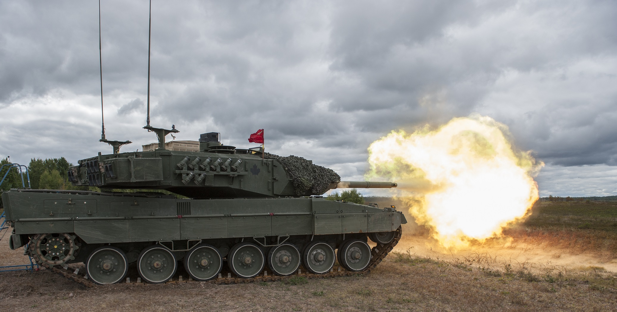 A Leopard II tank fires during exercise COLLABORATIVE SPIRIT at 4th Canadian Division Support Base Petawawa in Ontario on September 20, 2016.