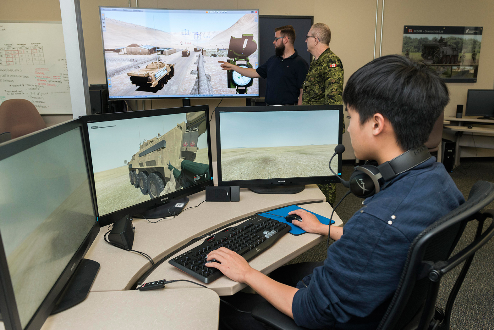Tim Yu, a co-op student, trials military equipment through a computer simulation