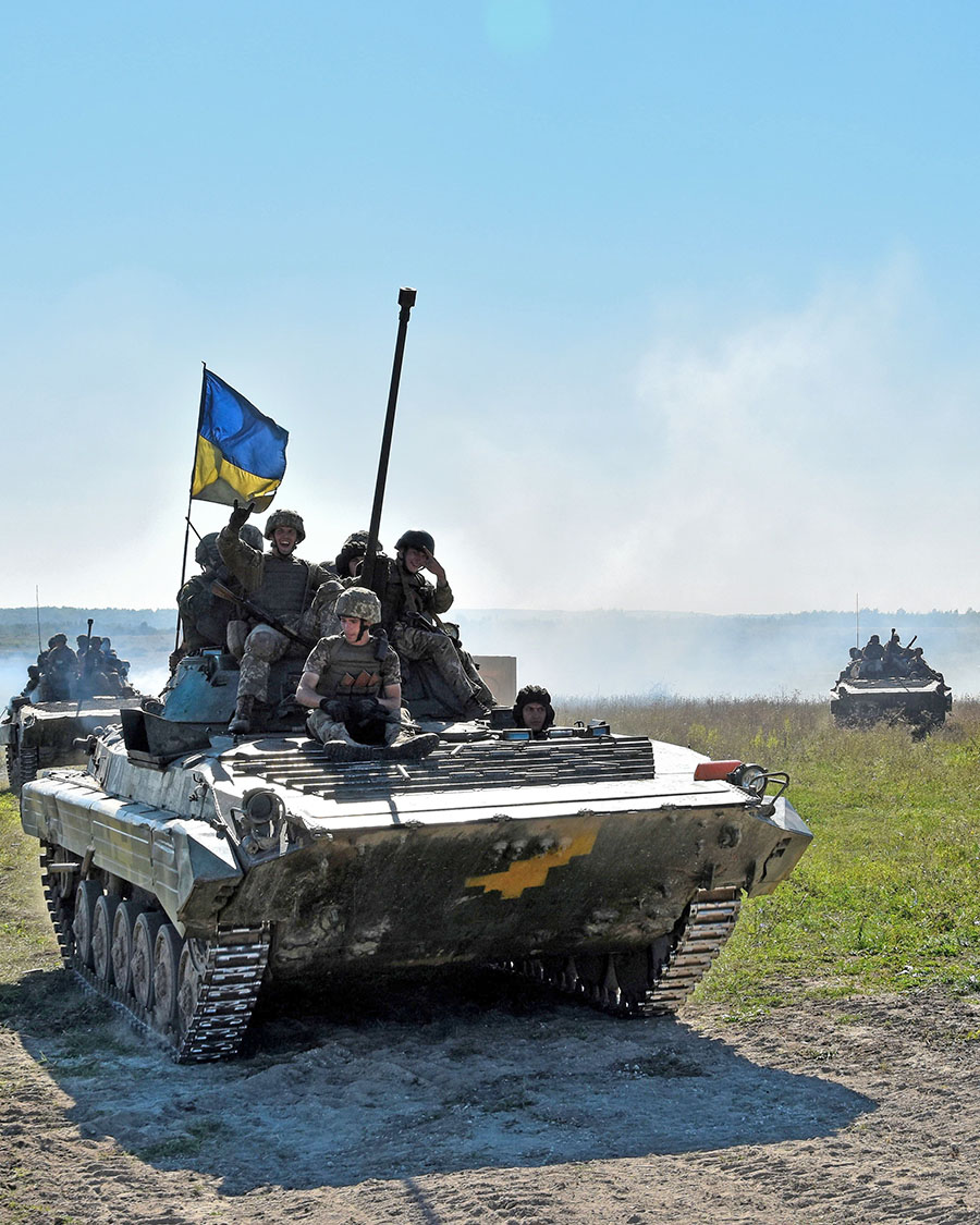 Ukrainian trainees are transported by BMP-2 infantry fighting vehicle during company offensive drills as part of Operation UNIFIER at the International Peacekeeping and Security Centre in Starychi, Ukraine, on Sept. 15, 2016.