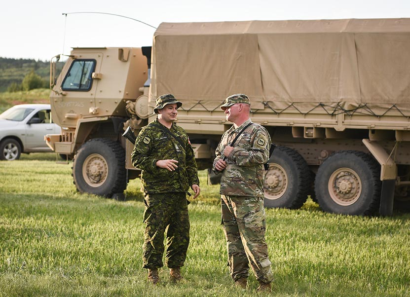 Chief Warrant Officer Ramsay Bellisle talks with Sergeant Nathan Hedin